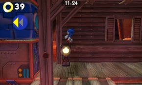 Sonic jumping towards a blue crate.